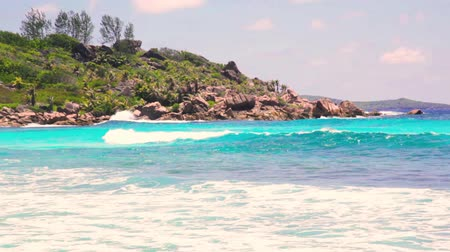 la digue island : small waves and white beach at Seychelles islands. La Digue, Anse Cocos.
