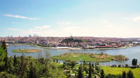 khan : Cemetery Sultan Eyup, The Halich Bridge and panoramic view of the Golden Horn Bay in Istanbul, Turkey. Stock Footage