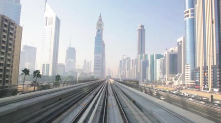 skyscrapers business center on blue sky background and Metro Train in Dubai, United Arab Emirates.