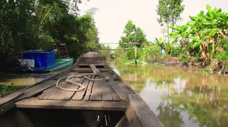 Vietnam, a wooden sailing boat in the Mekong Delta