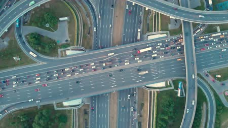 Aerial top view of road junction in Moscow from above, automobile traffic and jam of many cars, transportation concept.