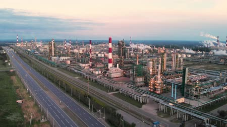 distillation : Oil refinery plant industry, Refinery factory, oil storage tank and pipeline steel with sunrise and cloudy sky background, Russia.