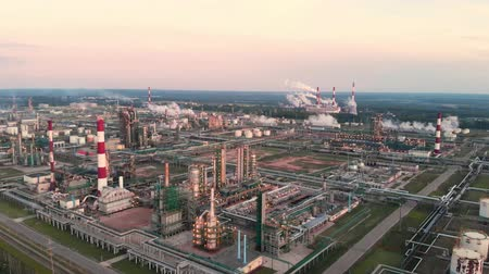 rurociąg : Oil refinery plant industry, Refinery factory, oil storage tank and pipeline steel with sunrise and cloudy sky background, Russia.