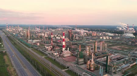 petroleum refinery : Oil refinery plant industry, Refinery factory, oil storage tank and pipeline steel with sunrise and cloudy sky background, Russia.