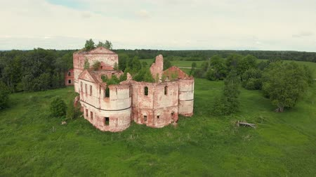 Ruins of the old orthodox church in an abandoned village in the middle zone of Russia, Vologda region. view from above Stock Footage