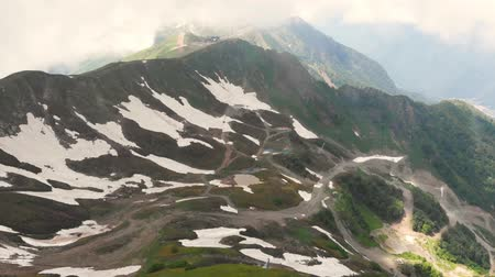 hegyoldalban : Flight of the camera over mountains. Aibga Ridge. ski slope in summer. Mountains near the ski resort of Rosa Khutor in Krasnaya Polyana. Sochi.