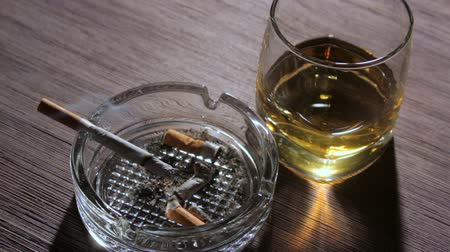 self harm : igarette and glass of whiskey on the table Stock Footage