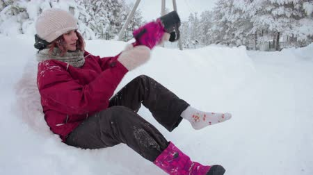 sock : Girl wiping snow out of her shoes