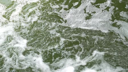 sputter : Beautiful green water in mountain river slow motion video