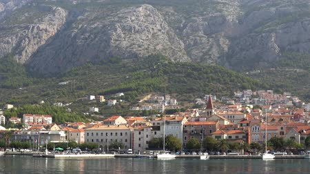 torre sineira : Europe. Croatia. View of the town of Makarska from the sea summer day Stock Footage