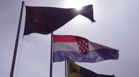 chorvatský : Croatian flag is developing in a strong wind against the sky
