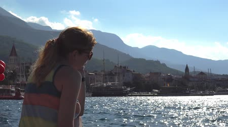 croatia : Croatia. young girl on the pier admires the city of Makarska Stock Footage