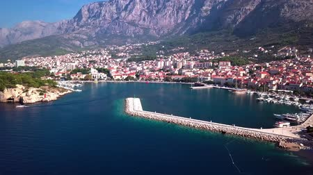 templomtorony : Makarska, Croatia: panorama of the city Harbor with a view of the sea and the mountains shooting with the drone