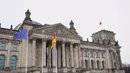 bundestag : Berlin.Germany. Parliament of the Bundestag and the developing German flag Stock Footage