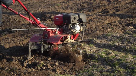 tillage : Agriculture. Farmers car. Cultivator mills plowing the ground