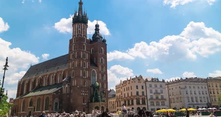 street market : Krakow Poland June 2019. St. Marys Basilica in the old town. timelapse