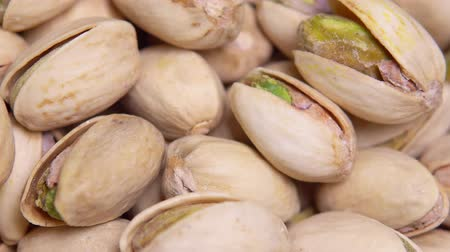 kernel : close up. macro. Fried pistachios in a shell rotate in a circle. background