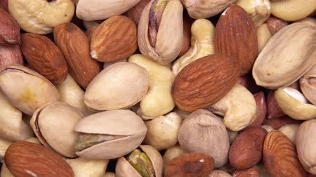 nootjes : close up. background of nuts. different types of nuts rotate in a circle