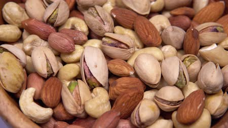 fıstık : close up. background of nuts. different types of nuts rotate in a circle