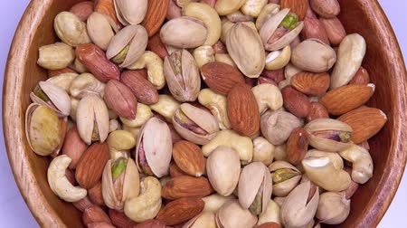 moer : close up. background of nuts. different types of nuts rotate in a circle