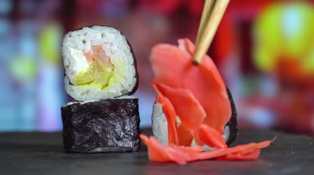 california rolls : Sushi rolls close up take chopsticks Stock Footage