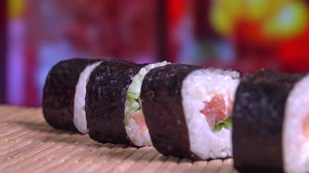 васаби : Sushi rolls close - up rotate in the restaurant