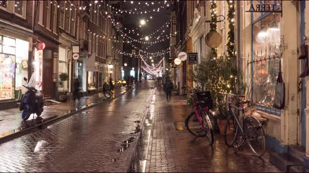 голландский : Amsterdam, Netherlands - December 2018. Time lapse of the Christmas street