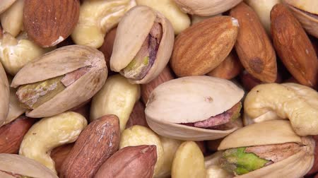 pistacje : close up. background of nuts. different types of nuts rotate in a circle
