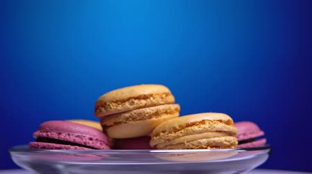 macarons : French macarons, sweet cookie spinning close-up