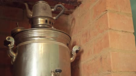 bathhouse : Russian samovar is heated on the stove close up Stock Footage