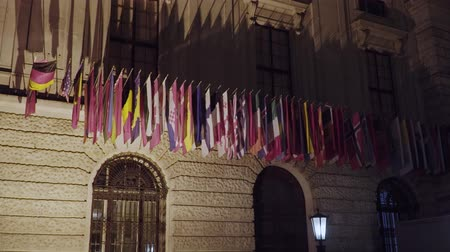 multikulturní : Flags of the OSCE participating States on the headquarters building in Vienna