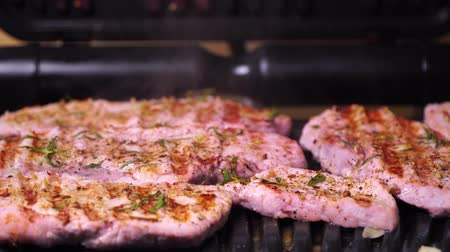 sirloin : Close-up of pork production. Pork steak fried on a grill Stock Footage