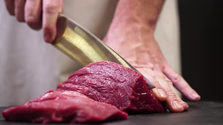 sirloin : Chef cuts beef for steak. Stock Footage