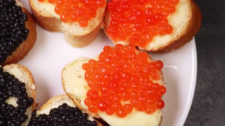 kaviár : appetizers with red and black caviar close up rotate on a plate