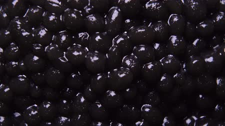 slanina : background of black natural caviar close up