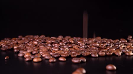 dark roast : Close-up of falling grains on a black background Stock Footage