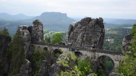 saxon : Video footage of the Bastei Bridge in Saxon Switzerland, Germany. Sandstone rocks, cloudy and windy weather. Stock Footage