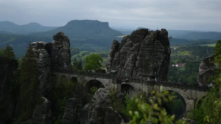 saxon : Timelapse video footage of Bastei Bridge in Saxon Switzerland, Germany. Sandstone rocks, cloudy and windy weather.