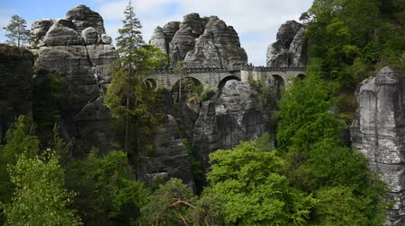 bástya : Timelapse video footage of Bastei Bridge in Saxon Switzerland, Germany. Sandstone rocks, cloudy and windy weather.