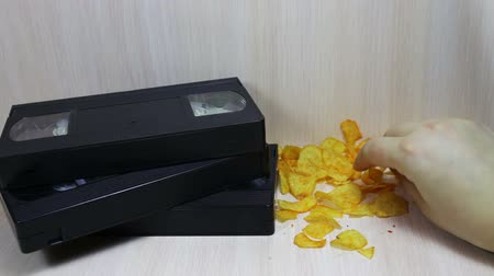 videocassette : stack of video tape cassette and potato chips
