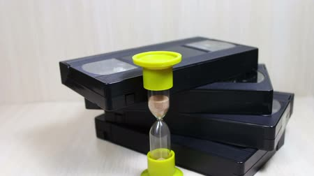 videocassette : stack of VHS video tape cassette and hourglass