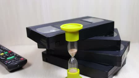 videocassette : stack of video tape cassette and hourglass
