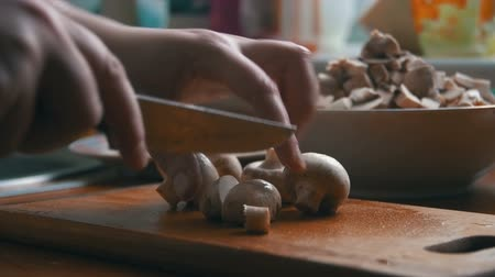 shiitake : Slicing mushrooms on a kitchen board