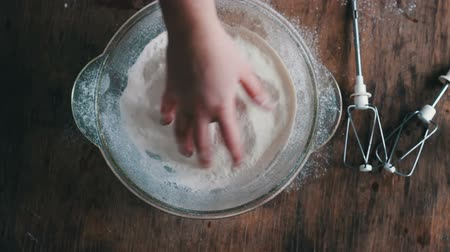 sifting : Top view of hands stirred the flour with a hand. Stock Footage