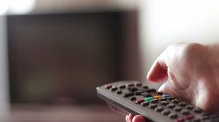 comutar : human hand changes the channels on the TV remote control Stock Footage