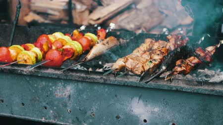 shish kebab : Tasty fresh meat strung on a skewer is fried on brazier. Shish kebab from pork and vegetables