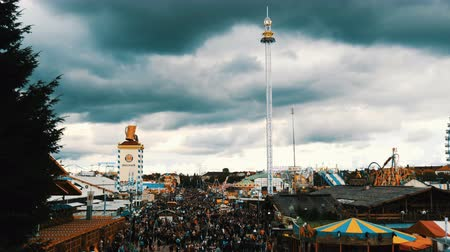 literário : September 17, 2017 - Oktoberfest, Munich, Germany:View of the huge crowd of people walking around the Oktoberfest in national bavarian suits, on Theresienwiese, top view