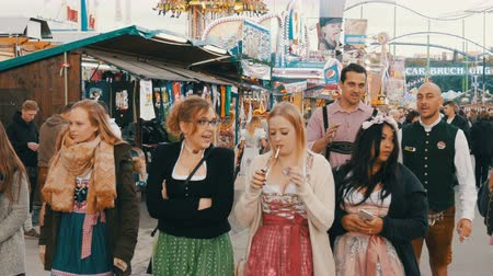 literário : September 17, 2017 - Oktoberfest, Munich, Germany: crowd of people walking and have fun around the world beer festival near attractions and tents with food Stock Footage