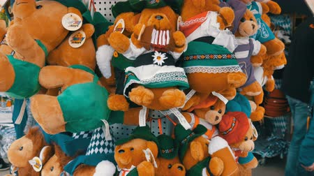 literário : September 17, 2017 - Oktoberfest, Munich, Germany: Large number of souvenir bear cubs of oktoberfest characters. World Beer Festival in Bavaria Stock Footage