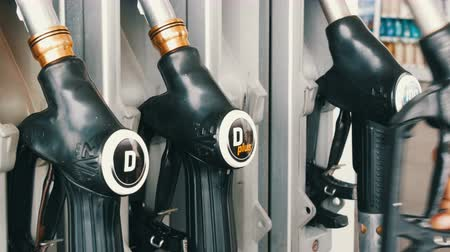 literário : October 2, 2017 - Gorizia, Italy: Different old refueling pistols for pouring gasoline hang in row at the gas station.Gasoline or petrol station gas fuel pump nozzle